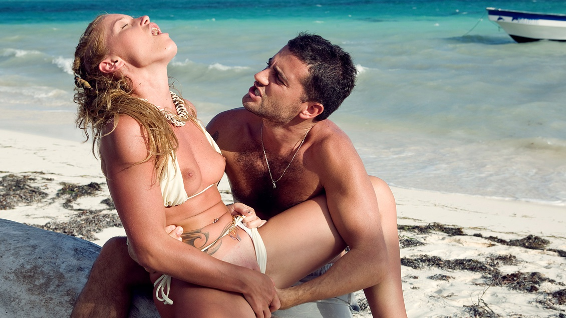 This Couple Relaxes on the Tropical Beach and Has Oral Sex Together